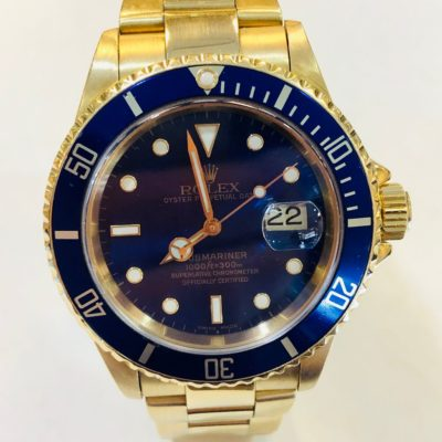 Rolex Oyster Perpetual Submariner 18KT Men's Yellow Gold watch